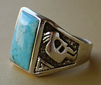 A Kokopelli Indian native american tribal symbol is on this sterling and blue turquoise men's ring