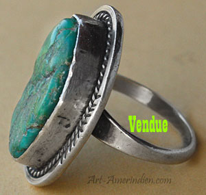 A rough turquoise is serrated on this vintage navajo ring